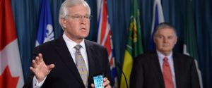 Frank Clegg, of Canadians For Safe Technology (Former President of Microsoft Canada,) looks on from right as Conservative MP Terence Young calls for tougher warnings on cell phones during a press conference on Parliament Hill in Ottawa on Monday, January 19, 2015. Terence announced multi-party support for his private member
